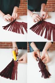 starting at the loop roll your piece of fringe and add dots of hot glue every two inches make sure that the top edge stays even and