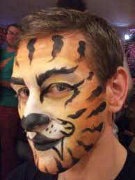 a photo of a man with his face painted like a tiger