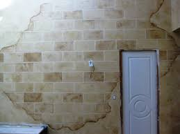 array of color inc distressed faux block wall