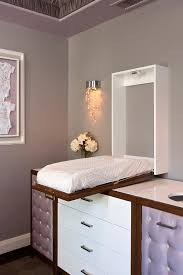 Glam Nursery with Wall Mount Concealed Drop Down Changing Table