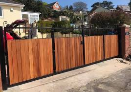 bi fold entrance gates ideas split into 4 gate sections with feature header