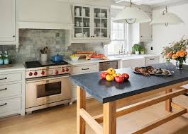 freestanding wood frame kitchen island with dark gray concrete countertop