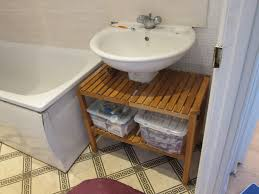 unique wooden storage completing white pedestal sink added net to rectangular tub