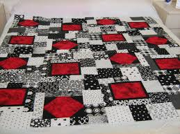 Black, white and red quilt &  Adamdwight.com