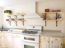 kitchen ivory wooden wall mounted shelves on white wall plus white wooden cabinet having grey
