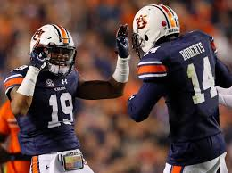 auburn s nick ruffin left and stephen roberts after the tigers handed alabama its first defeat of the season on saay in the iron bowl