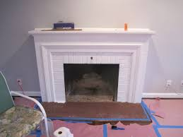 after a couple coats of paint and some metallic spray paint our fireplace has gone from majorly drab