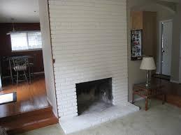 white painted brick fireplace standard