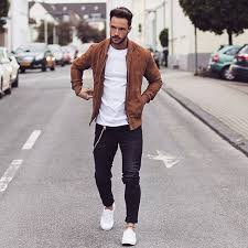 black jeans a classic white t shirt a brown suede jacket and white