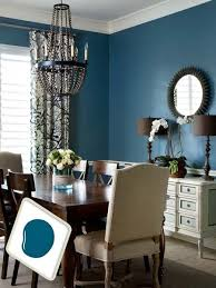 this enveloping blue tinged with green and black sets off clic white painted crown molding and chair rail beautifully for a similar look