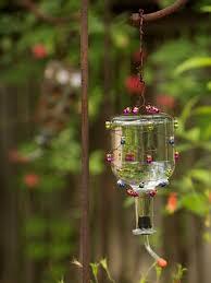 maderemade michelle reynolds tequila bottle hummingbird feeder s3x4