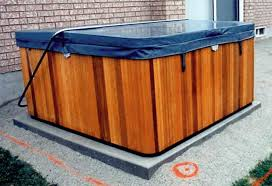 new hot tub sitting on a concrete pad