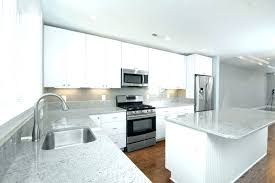 white glass backsplash kitchen with white cabinets