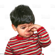 Baby With Hand On Face Feeling Sad Stock Photo - Download Image Now - iStock