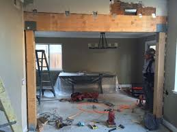 construction of the replacement of a load bearing wall with a beam here the framework