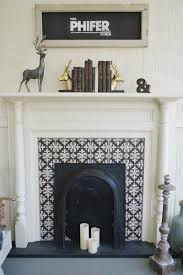 original fireplace in a southern fixer upper repurposed as a decorative accent on the covered porch cement tile surround