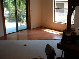 undercutting a fireplace to install laminate or hardwood flooring under it
