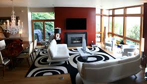contemporary casual living room with black and white decor and open floor plan next to dining