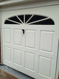 sold subject to collection white garage door
