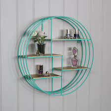 this circular wall shelf that is perfect for displaying ornaments in a fantastic modern contemporary and minimalistic style that will look great in the