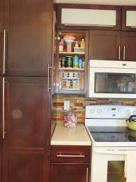 kitchen cabinet and lazy susan cabinet with lazy susan cabinet hardware also stacked stone tile backsplash and white appliances plus granite countertops