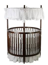 Circular design on this crib from Dream On Me allows for high visibility  for parents.
