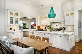 i love this traditional farmhouse kitchen with two large ring chandeliers over the island space