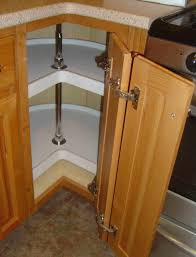 kitchen design with lazy susan cabinet and lazy susan corner cabinet also blind corner optimizer with quartz countertops and cooktop plus tile flooring with