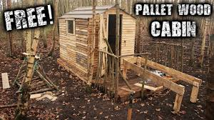 Pallet Cabin Designs Building An Off Grid Cabin For Free To Save Money Woodstove Pallet Wood Bed