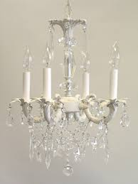 white chandelier with four candle lamps combined with semi oval also stars hanging ornaments