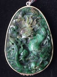 hand carved vintage green jadeite dragon pendant set in 14k gold not silver