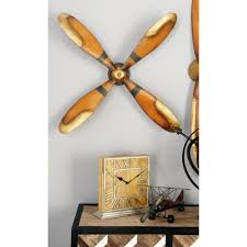 4 blade vintage iron caramel brown and gold plane propeller wall decor 54982 the home depot