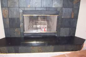 this slate fireplace has beautiful earth tone slate tiles