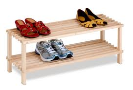 natural brown wooden shoe rack with bars on the two shelves plus short legs