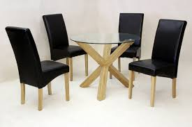 heartlands saturn round dining table in clear glass with 4 glass dining table with white chairs