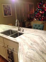 white cabinets with brown granite fantasy brown granite in kitchen for the home off white kitchen white cabinets with brown granite