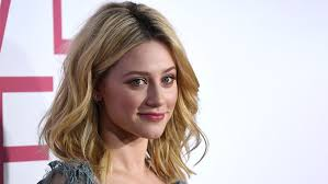Lili Reinhart says she's 'nostalgic for my quarantine life' as she shares topless pic and snapshots with pals | Fox News