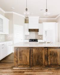 Modern white rustic kitchen featuring custom shaker cabinetry, dark ...