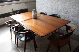 small rustic dining room spaces with antique and vintage rectangle wooden dining table for 6 chairs with black leather cushions and back with wooden frame