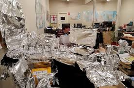 desk wrapped in tin foil