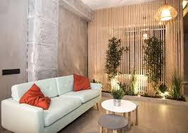 adding uplights and some greenery to a slatted room dividing wall create a zen vibe image futurcret
