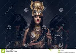 Portrait Of Haughty Egyptian Queen In An Ancient Pharaoh Costume With Two  Concubines.