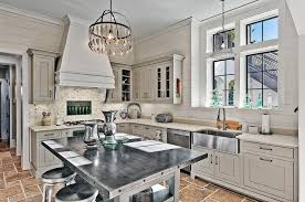 zinc top kitchen island with silverware chandelier