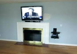 tv above fireplace wires wall mounted hiding wires gorgeous mount on brick fireplace hide wires minimalist of best shelf how to mount tv over fireplace