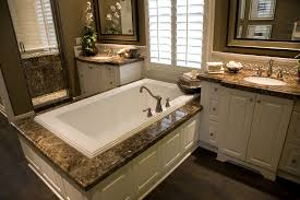 white bathroom cabinets with dark countertops. Dark Marble Countertops Over White Wood Cabinetry Match The Twin Vanities With This Soaking Tub Enclosure Bathroom Cabinets T