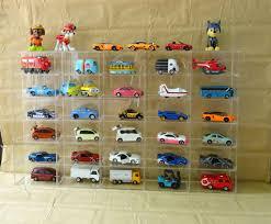 Kệ Mica trong suốt 30 ô, mỗi ô kích thước 10x5x5cm trưng bầy Đồ chơi xe mô  hình Tomica 52x32x5cm (Không bao gồm xe) - 285,000