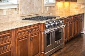 how to paint wood stained cabinets
