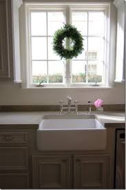 ideas kitchen windows angie the look for the lake sink and counter tan cabinets and cement counter
