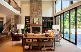 cozy modern living room with fireplace. A Simple Wooden Console Table Provides Storage And Creates Barrier Between The Seating Area Cozy Modern Living Room With Fireplace