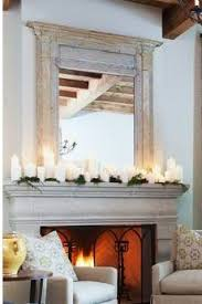 Beautiful mantle dcor for the winter with Candle Impressions Flameless  Pillars. The mirror really makes